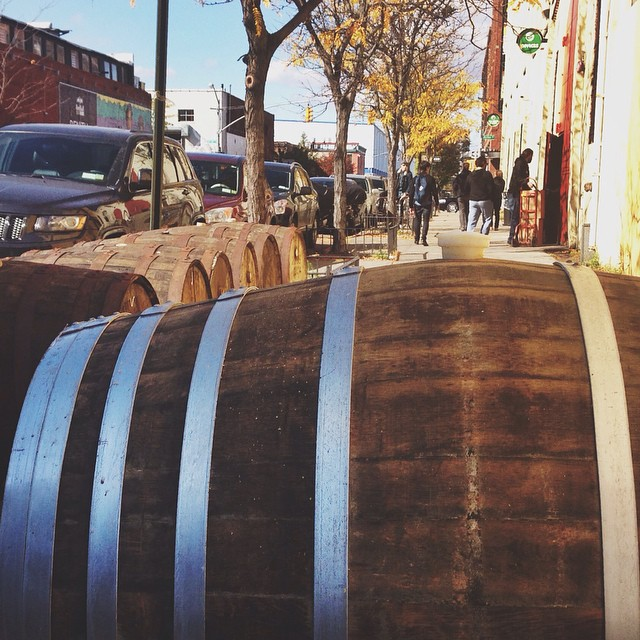 Autumn leaves and a sidewalk lined with beer filled rum barrels ?